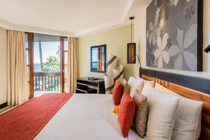 the warwick resort fiji suite bedroom with balcony